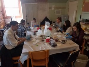 Volunteers cleaning and restoring items
